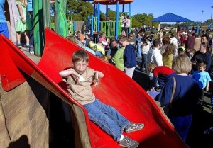 Brendan Sliding down a slide at his accessible playground