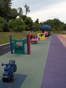 transportation pieces on accessible playground
