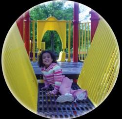 Girl Playing on Playground Deck