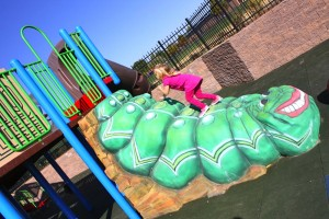 A climber in the shape of an inch worm in inclusive playground