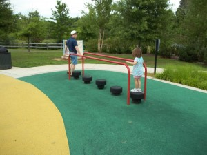 more difficult balance beam at accessible playground