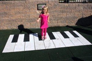 Make music with a large floor piano at inclusive playground