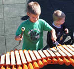 Children play musical instruments from Freenotes at inclusive playground