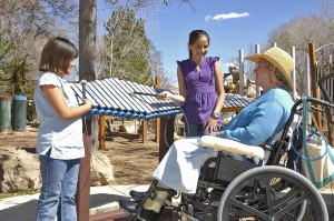 multigeneration inclusive playground--man plays instrument