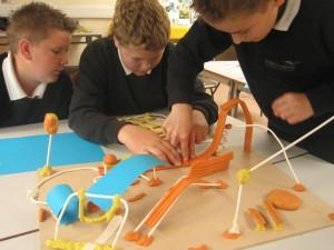 children build playground out of art supplies
