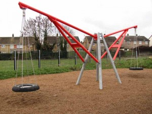 One set of swings at an adventure playground in UK
