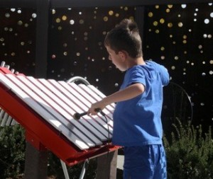 child with autism playing a Freenotes instrument
